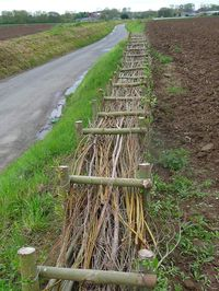 Wooden barrier in access road in vineyard resize